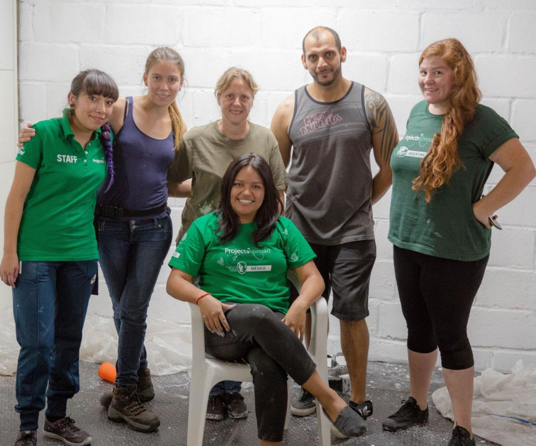 Volunteers and local Mexican staff work together for the community at a shelter for migrants.